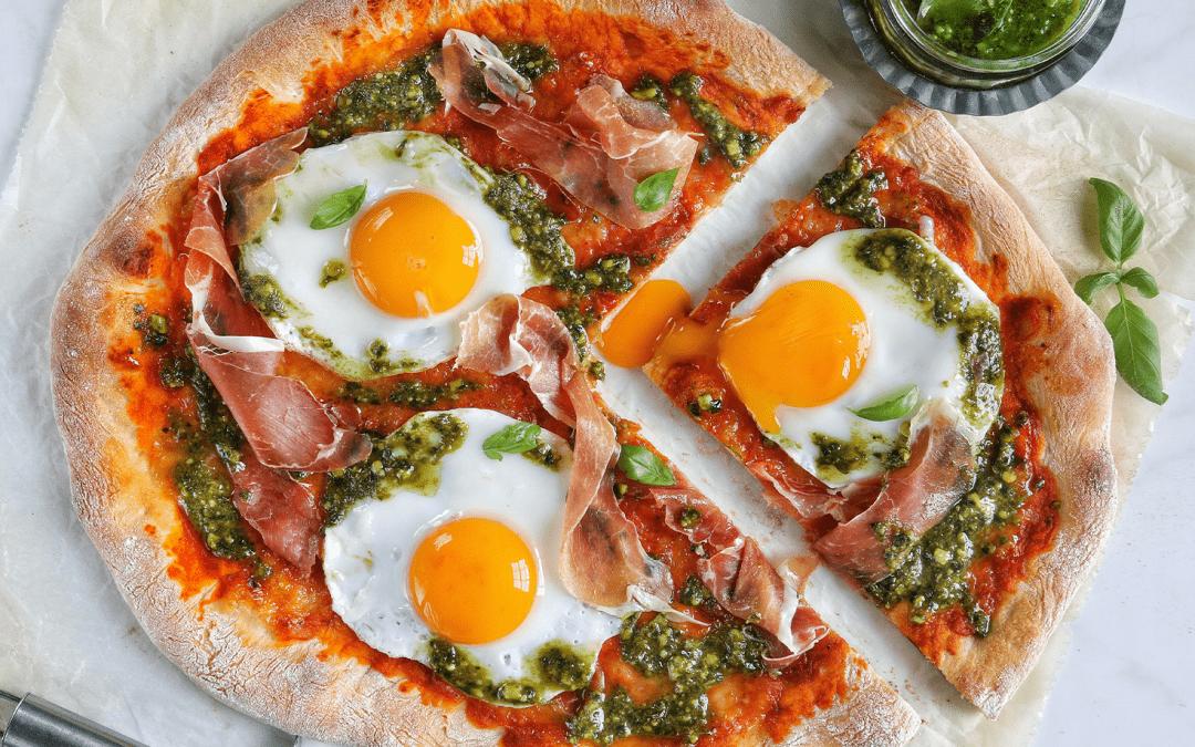 Pizza with Eggs, Prosciutto, + Green Pesto